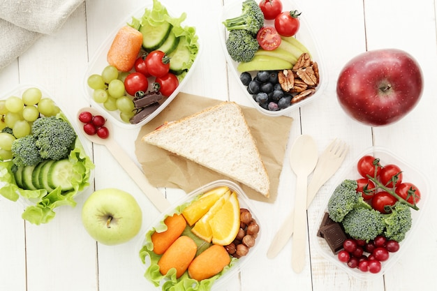 Lunch boxes with healthy food Free Photo