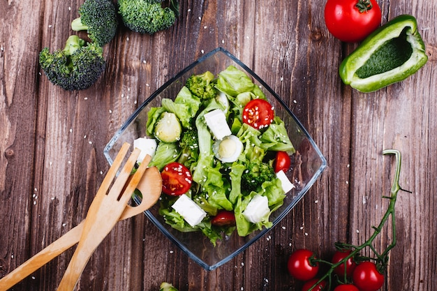 Lunch or dinner ideas. fresh salad of greenery, avocado, green pepper, cherry tomatoes Free Photo