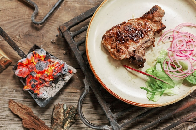 Lunch grilled meat pork on vintage wood table in rustic style. bbc food. Premium Photo