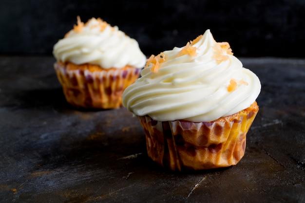 Lush homemade carrot cupcakes. Premium Photo
