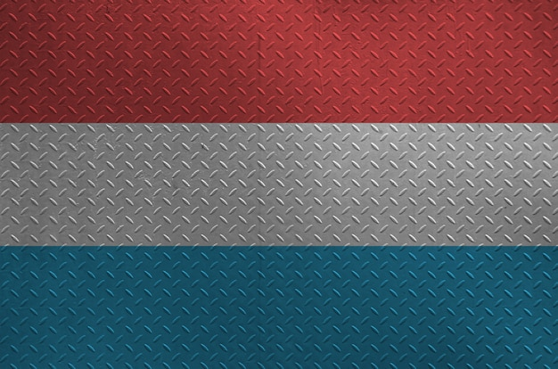 Luxembourg flag depicted in paint colors on old brushed metal plate or wall closeup. textured banner on rough background Premium Photo