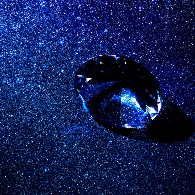 Luxurious diamond on shiny glitter texture abstract background Free Photo