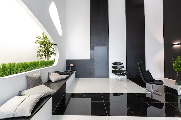 Premium Photo Luxurious Futuristic Trendy Modern Interior In Contrasting Black And White Colors With Interesting Fashionable Black Furniture And Decorated Wall