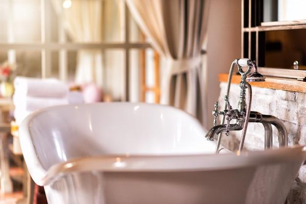 Luxurious vintage style bathroom inside the house Premium Photo