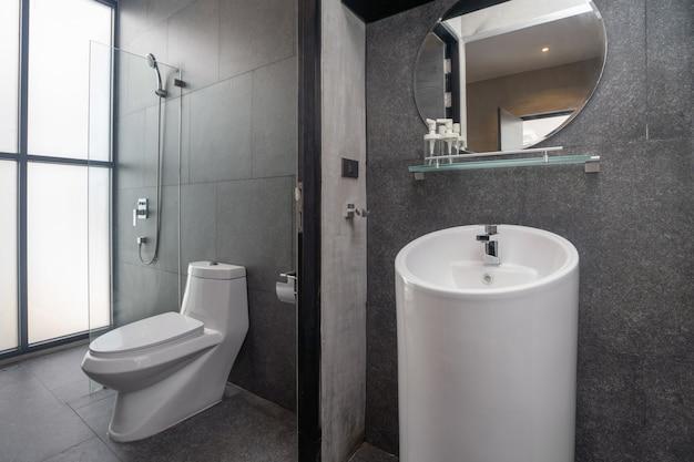 Luxury bathroom features basin, toilet bowl Premium Photo