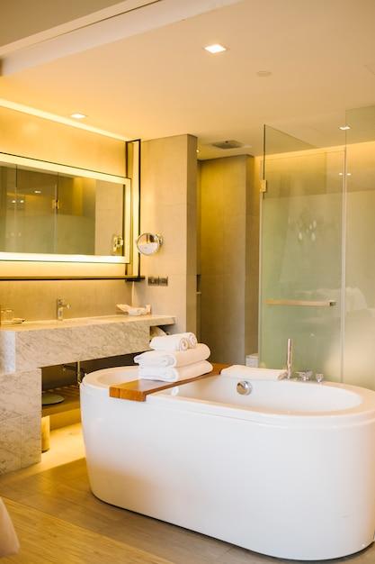 Luxury bathtub inside bedroom in hotel Free Photo