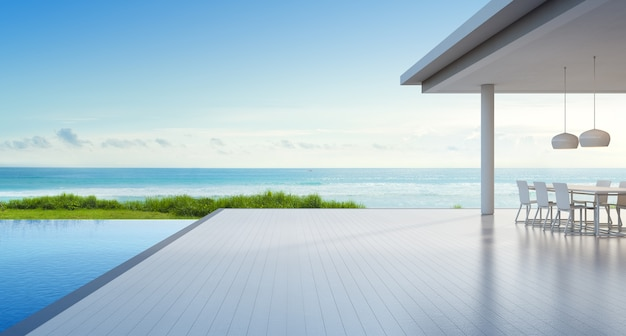 Luxury beach house with sea view swimming pool and empty terrace in modern design Premium Photo
