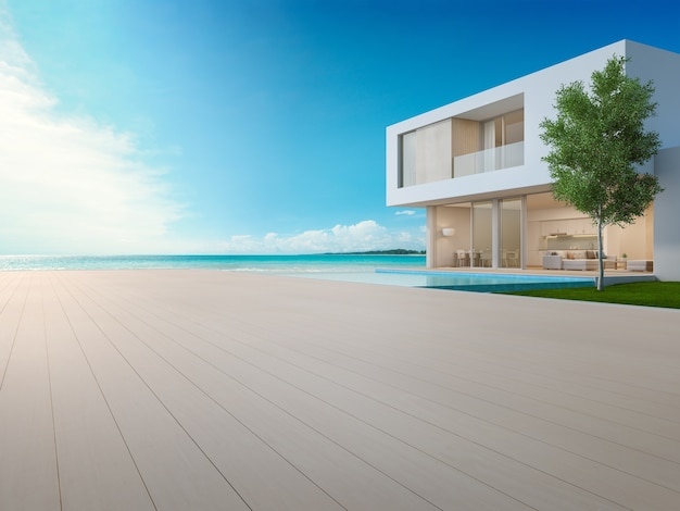 Luxury beach house with sea view swimming pool and terrace in modern design. Premium Photo