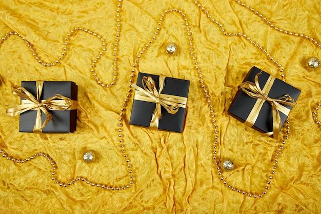 Luxury black gift boxes with gold ribbon Premium Photo