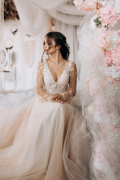 Luxury bride wearing her wedding dress Free Photo