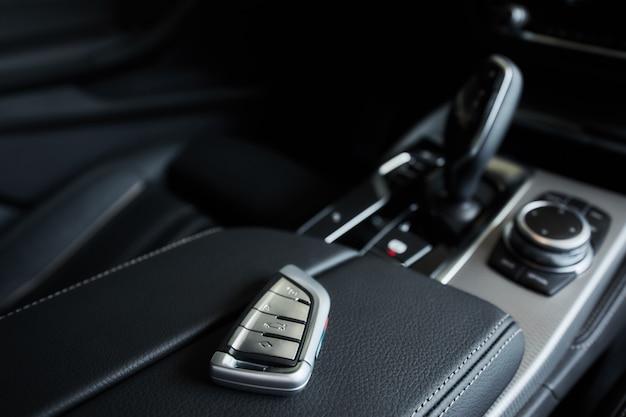 Luxury car inside, automatic gear stick of a modern car. Premium Photo