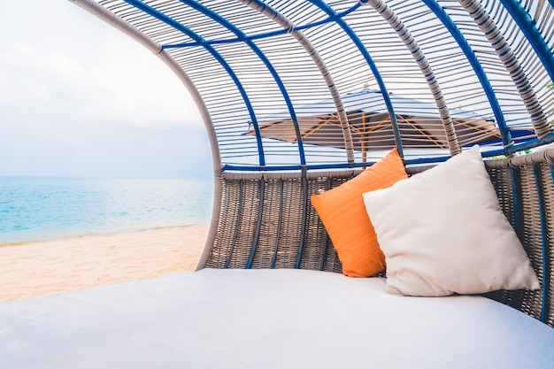 Luxury deck with pillow on the beach and sea Free Photo