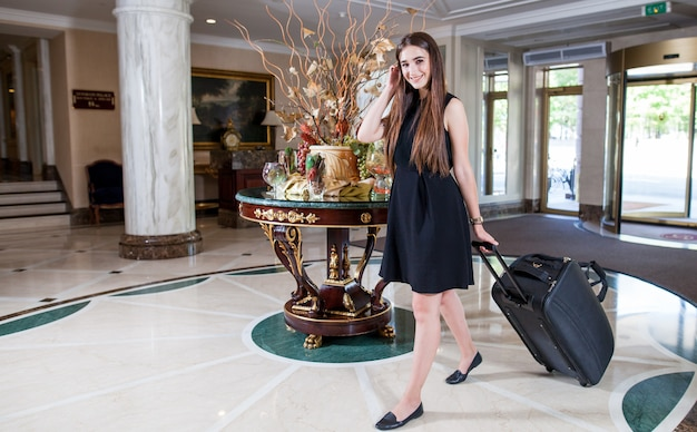 Luxury five-star hotel welcomes guests on a weekend. Premium Photo