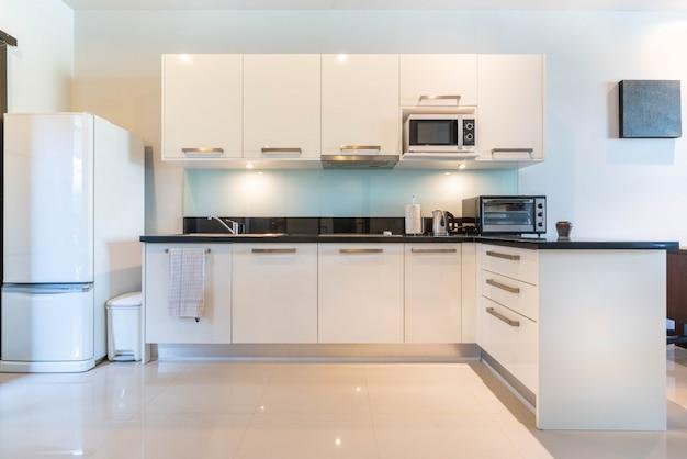 Luxury interior design  in kitchen area which feature island counter Premium Photo