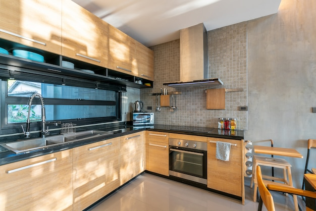 Luxury interior design in kitchen area with feature island counter and built in furniture in the house Premium Photo