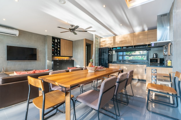 Luxury interior design in kitchen area with feature island counter and dining table Premium Photo