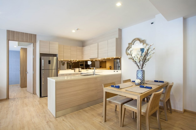Luxury interior design loft style  in kitchen area with feature island counter and dining table Premium Photo
