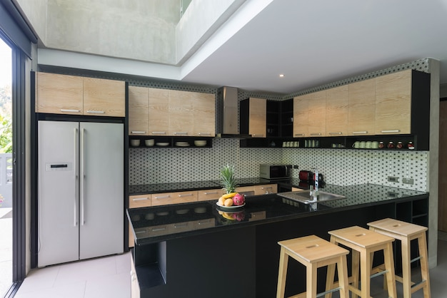 Luxury interior design loft style  in kitchen area with feature island counter Premium Photo