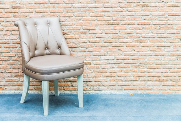 Luxury leather chair on brick wall background Free Photo