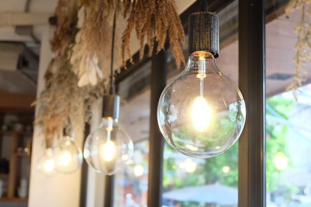 Luxury lighting decoration, light bulb hang from ceiling Premium Photo