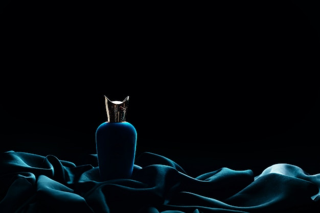 Luxury perfume on a black background Premium Photo