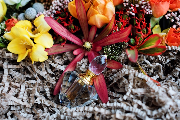 Luxury perfume bottle with flowers in the gift box. perfumery, cosmetics, fragrance collection. top view Premium Photo