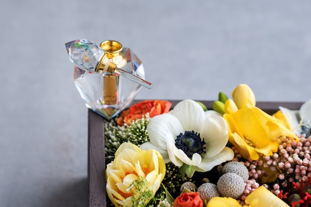 Luxury perfume bottle with flowers in the gift box. perfumery, cosmetics, fragrance collection Premium Photo