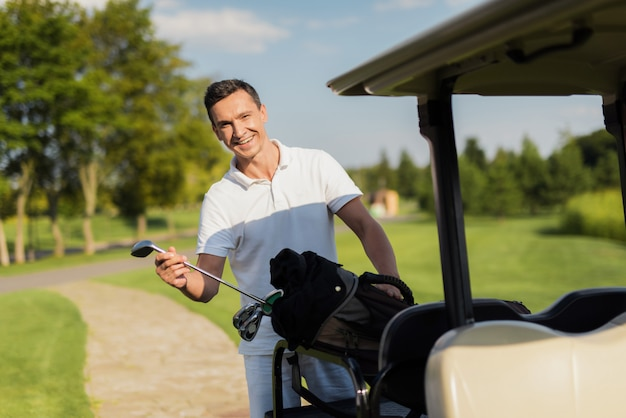 Luxury sport hobby golfer and golf clubs in car. Premium Photo