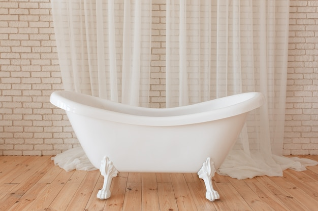 Luxury vintage bathtub on white brick background Free Photo