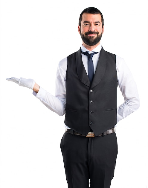 Luxury waiter holding something Free Photo