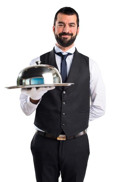 Cameriere di lusso che tiene un vassoio Foto Gratuite