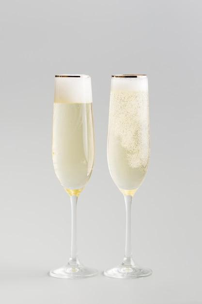 Luxury white wineglasses minimalist background Free Photo