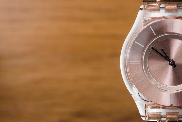 Luxury wristwatch on blur textured wooden backdrop Free Photo