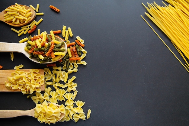 Macaroni isolated on the black background.cuisine concept. Premium Photo
