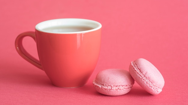 Macarons and cup Free Photo