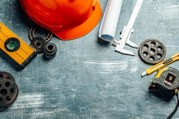 Machine engineer tools set on dark wooden background Premium Photo