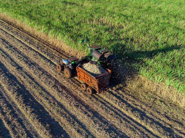 Machine harvesting sugar cane plantation aerial view Premium Photo