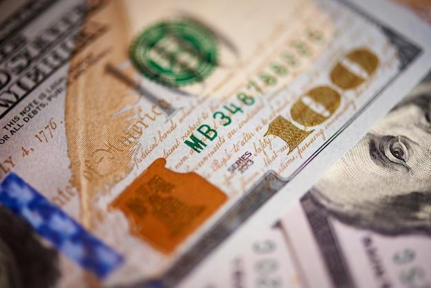 Macro of american paper money worth one hundred dollars, the new american bill. Premium Photo