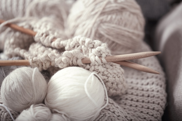 The macro concept of knitting wool and needles Premium Photo
