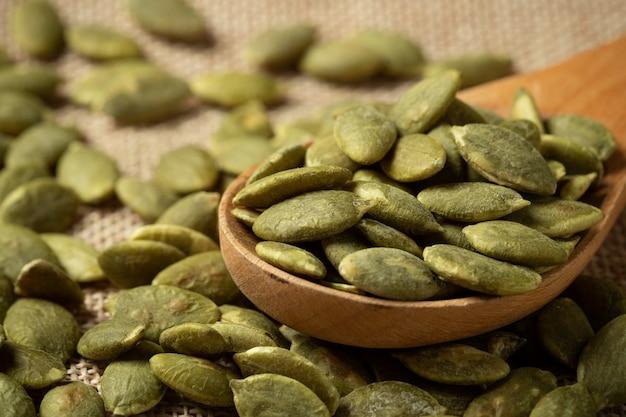 Macro green pumpkin seeds  texture . Free Photo