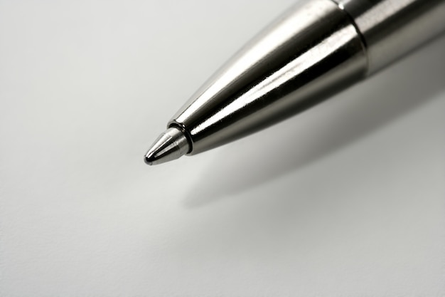 Macro roller silver gray pen point over white Premium Photo