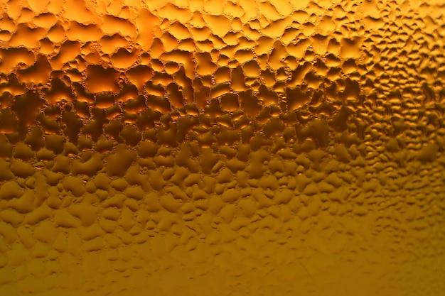 Macro shot of condensation on the bottle full of mixed herbs juice Premium Photo