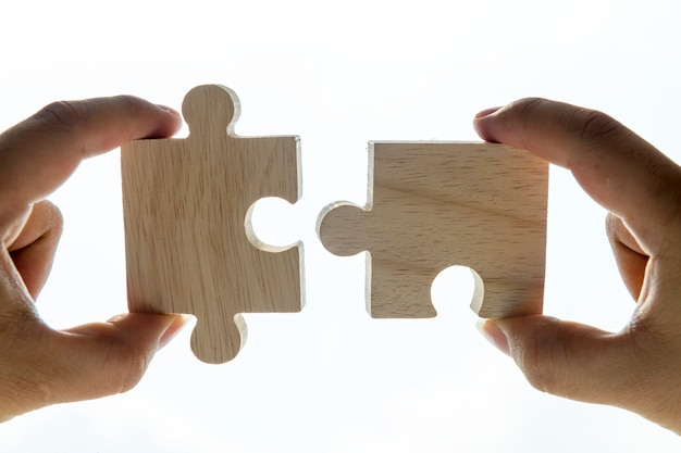 Macro shot of jigsaw puzzles teamwork concept Free Photo