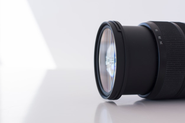 Macro shot of modern digital camera lens over white background Free Photo