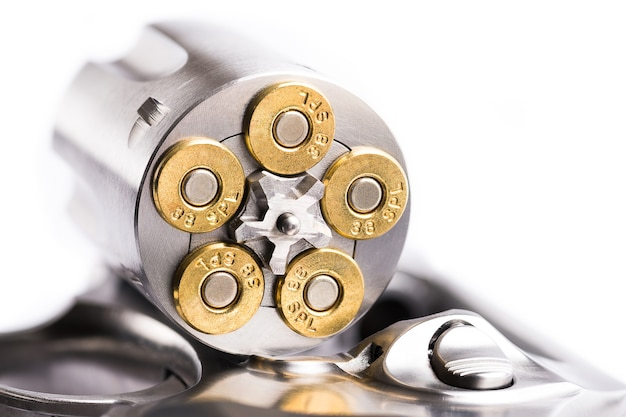Macro shot of an open revolver loaded with bullets Photo | Premium