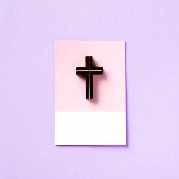 Macro shot of a small cross pendant Free Photo