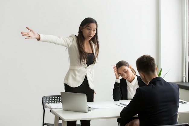 Mad hr representative pointing at door asking candidate to leave Free Photo