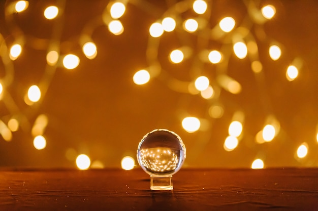 Magic ball and fairy lights Free Photo