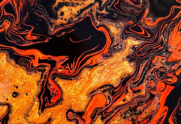 魔法のオレンジ-赤-金色。美しい大理石の効果。 Premium写真