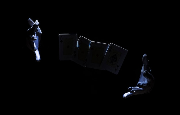 Magician's hand performing trick with playing card Free Photo